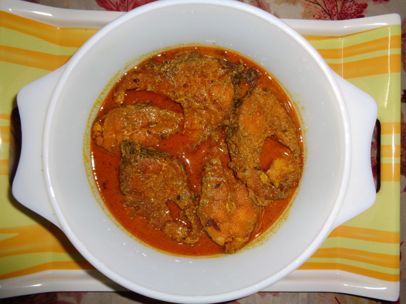Fried fish in mustard gravy.