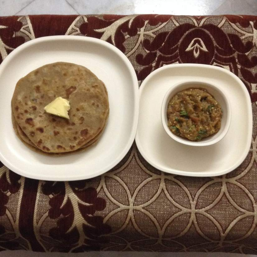 Roasted Gram Flour Parantha with mashed Brinjals.