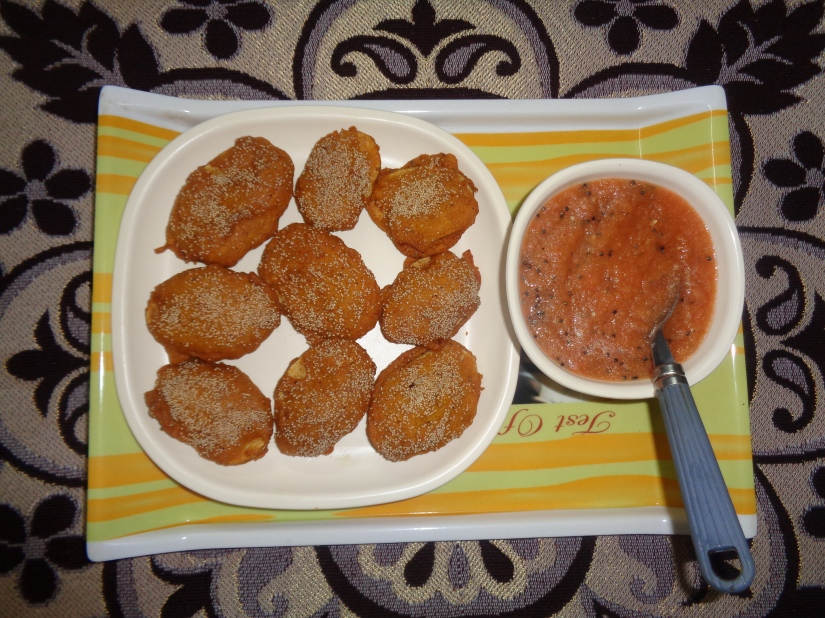 Crispy Potato Fritters and Tangy Tomato Chutney.