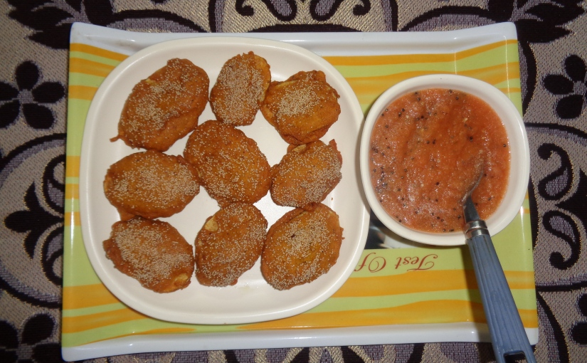 Crispy Potato Fritters And Tangy TomatoChutney