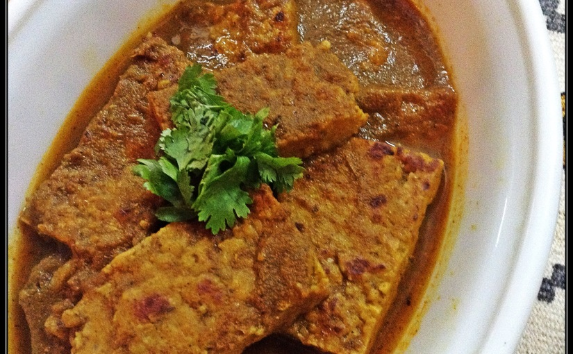 Shallow Fried Gram Flour Patties In Onion Gravy